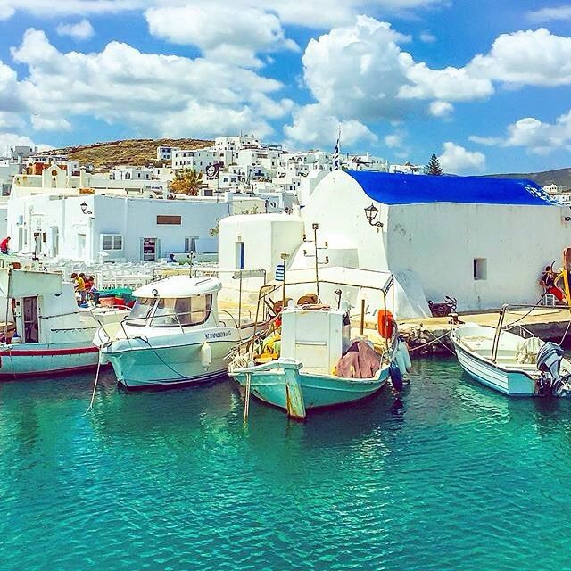The charming Naoussa village , at Paros island (Πάρος) . Very beautiful and traditional Cycladic village with little white houses and colorful fishing boats ! Great White & Blue , looks like a painting ... ☀️