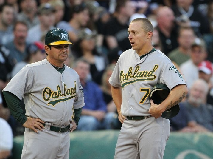 CHICAGO, IL - AUGUST 11: Mike Gallego #3 and Brandon Inge #7 of the Oakland Athletics chat on the field against the Chicago White Sox at U.S. Cellular Field on August 11, 2012 in Chicago, Illinois. (Photo by Tasos Katopodis /Getty Images): Athletic Chat, Oakland Athletics, Baseb Photo
