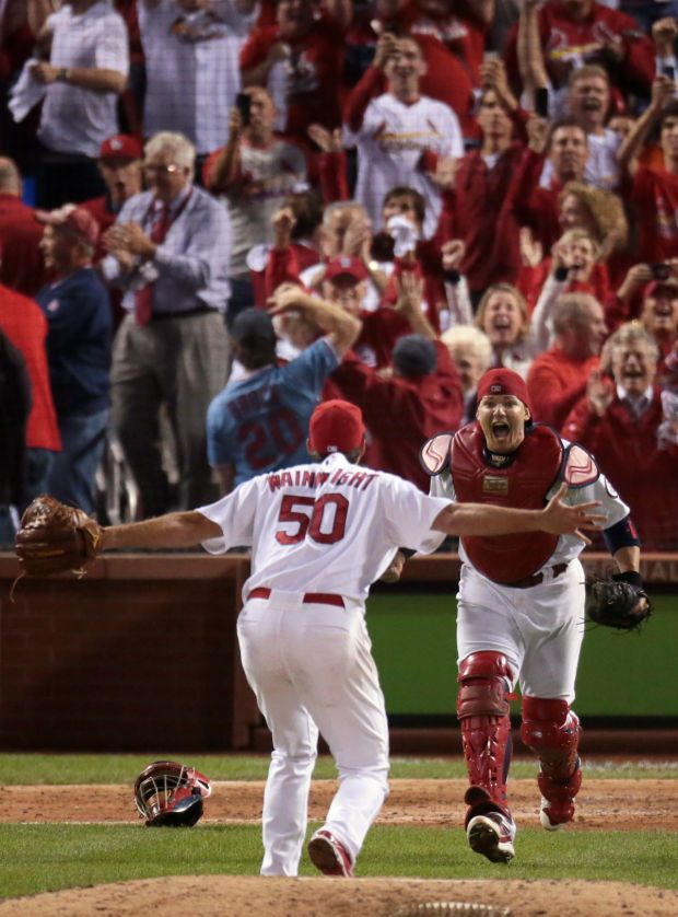 St. Louis Cardinals starting pitcher Adam Wainwright and St. Louis Cardinals catcher Yadier Molina celebrate the Cardinals series clinching ...