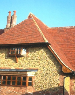 Product Used: Shire Colour: Downs Red/ Heritage/ Priory Mix Description: To put the true finishing touch on a dream home for architect and owner, Nigel Lyles, Chartwell lodge in Norfolk was topped with over 35,000 handmade clay Keymer tiles. The discretely individual look and colour of each of Keymer's Shire Heritage clay tiles can only come from being made by hand. Across this vast project the full colour range was specified - Downs Red, Heritage and Priory. This meant the entire roof…