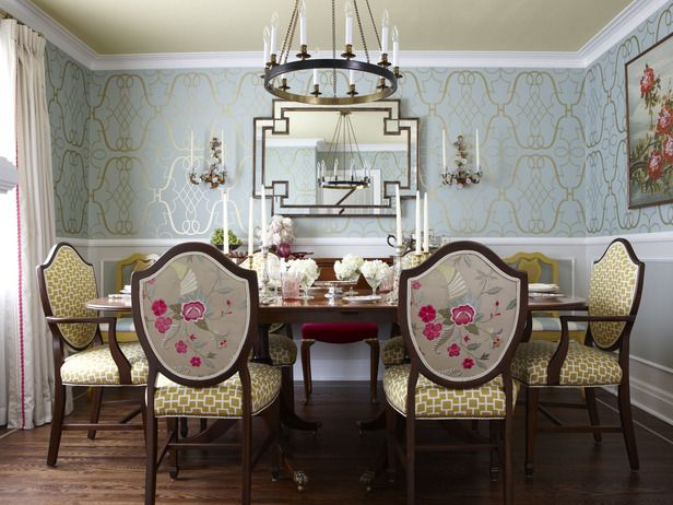 This soft blue and gold space benefits from the introduction of some unexpected bright pink. Design by Sarah Richardson
