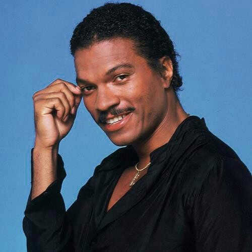 "William December ""Billy Dee"" Williams, Jr. (born April 6, 1937) is an American actor, artist, singer, and writer best known for his work as a leading man in 1970s African American cinema, in movies including Mahogany and Lady Sings the Blues, and for playing the character of Lando Calrissian in the movies Star Wars Episode V: The Empire Strikes Back and Star Wars Episode VI: Return of the Jedi."