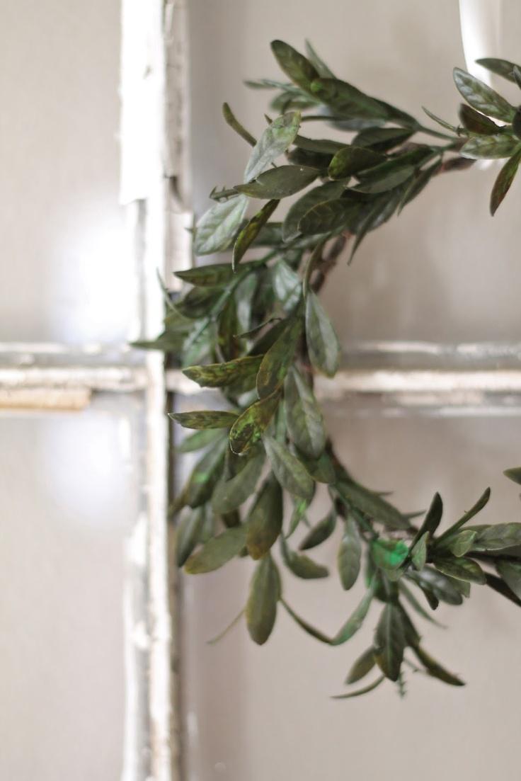 mini wreath on vintage window