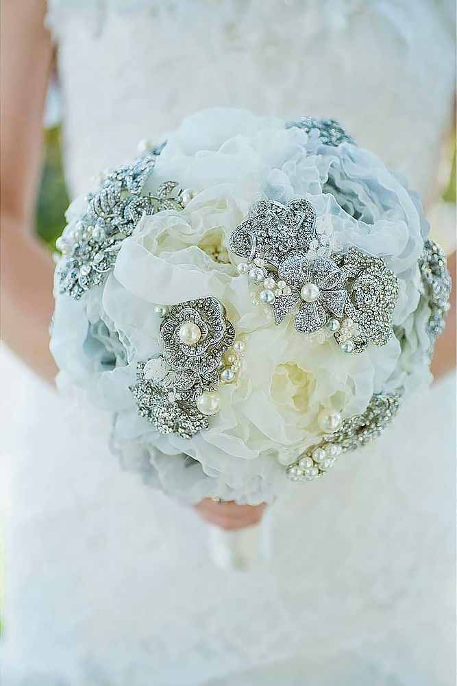24 Chic Brooch Wedding Bouquets With Bling ❤ They will stay in great condition for years unlike fresh flowers and be a reminder about this day. See more: http://www.weddingforward.com/brooch-wedding-bouquets/ #weddings #bouquets