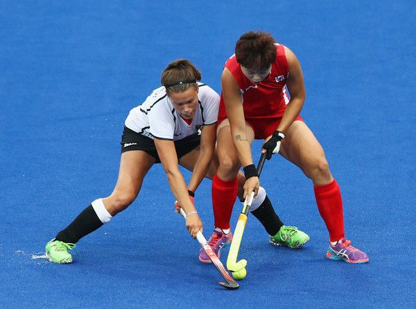 Charlotte Stapenhorst of Germany and Eeseul Baek of Korea battle for the ball during the Women's Pool B Match between Germany and Korea on Day 5 of the Rio 2016 Olympic Games at the Olympic Hockey Centre on August 10, 2016 in Rio de Janeiro, Brazil.