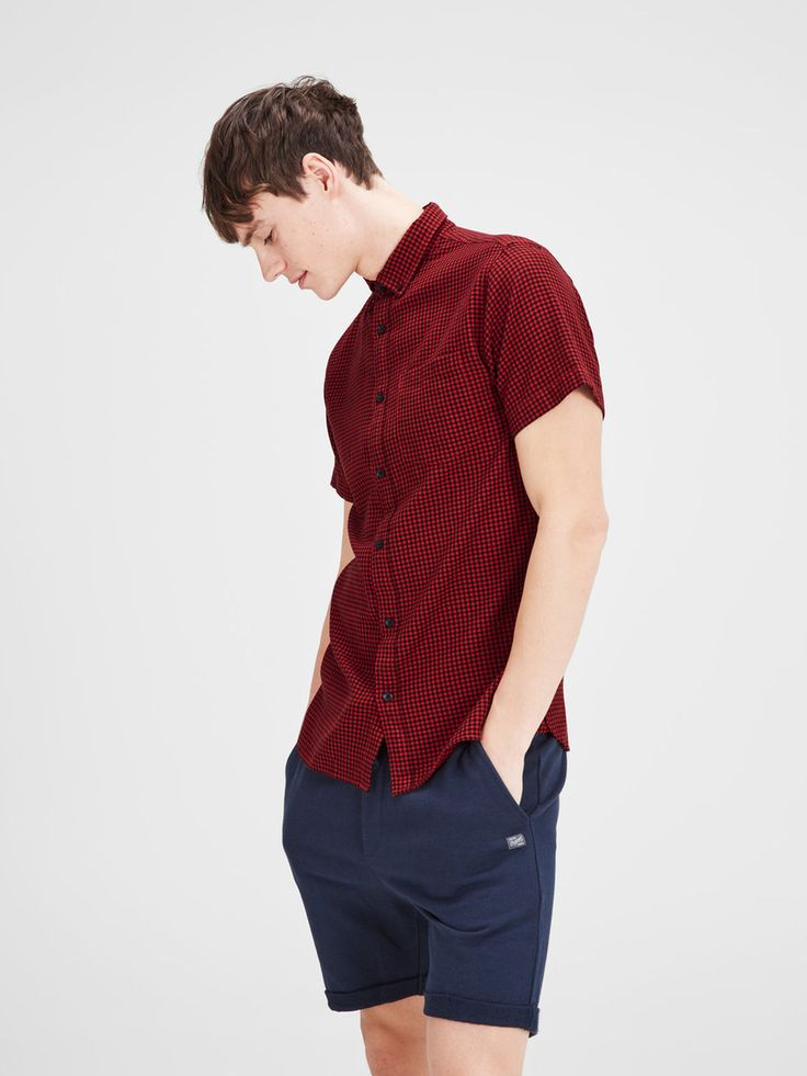 The perfect mix between looking cool, casual, smart and laid-back. Pair a short sleeved red shirt with blue chino shorts | JACK & JONES