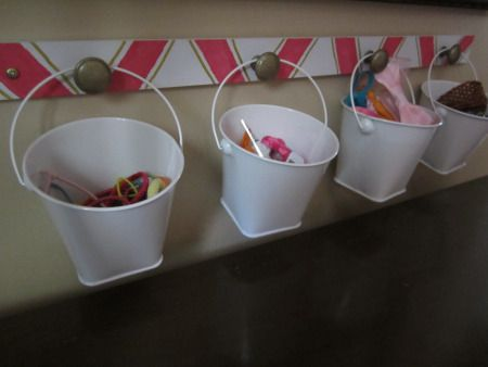 Accessory storage for a little girl's room. Mini pails for hair ties, clips, headbands and bracelets.