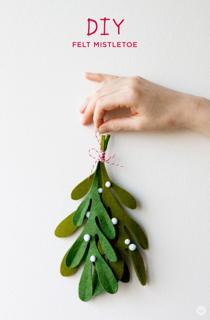 There's nothing like a handmade touch to make any gift feel extra special. We put a team of Hallmark designers on the creative case to make the coolest DIY felt gift attachments they could come up with. Take a gander, get inspired, and download our step-by-step instructions for making your very own felt mistletoe—a charming and easy last-minute holiday decoration idea.