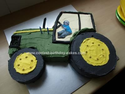 Homemade Tractor Cake with Driver: My husband and I made this Tractor Cake with Driver in 3 steps. 1) Bake the cakes - 1 13x9 cake and 2 standard round cake tins.  2) Refrigerate the cooled