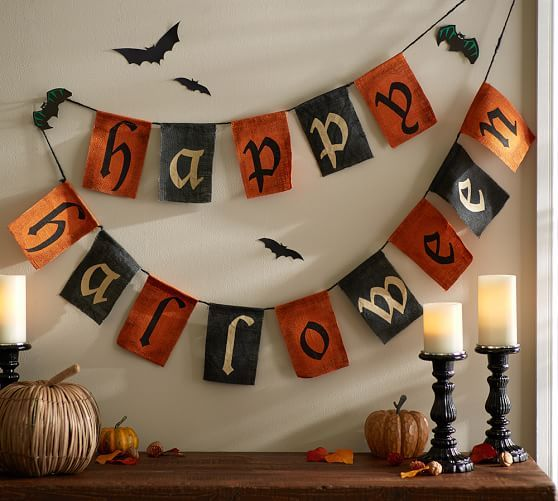 "Outdoor Happy Halloween #Banner! By Pottery Barn. Greet guests and trick-or-treaters with a seasonal sentiment and the colors of #Halloween. 7"" wide x 0.25"" thick x 72"" tall and made of burlap & jute."