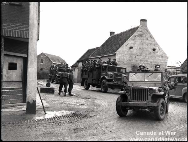 The Battle of the Scheldt - Seventh Bridgade, Third Canadian Division, moving through Backhouteto support the 8th and 9th, located at, Breskens, Netherlands, 18 October 1944.