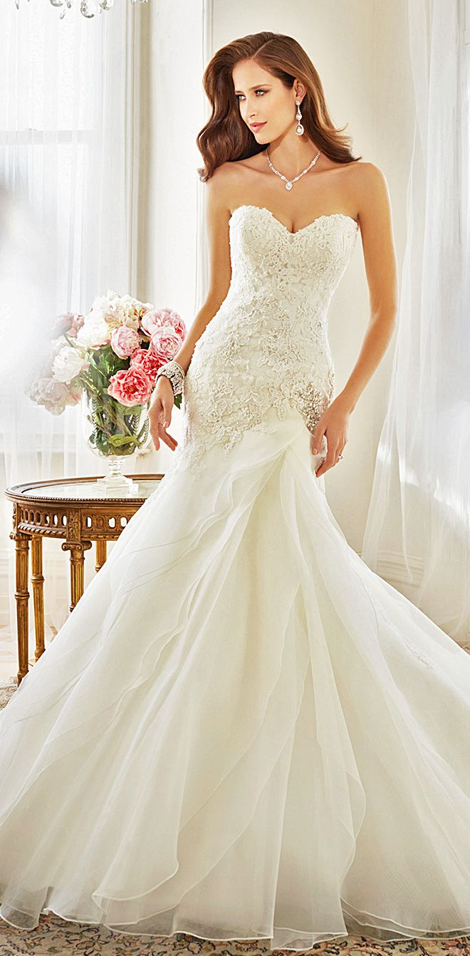 Elegant lace and tulle wedding dress by Sophia Tolli - hand-beaded, sleeveless, classic. See more: http://www.weddingforward.com/our-favourite-sophia-tolli-wedding-gowns-from-spring-2015-collection/ #weddingdresses #weddingdress