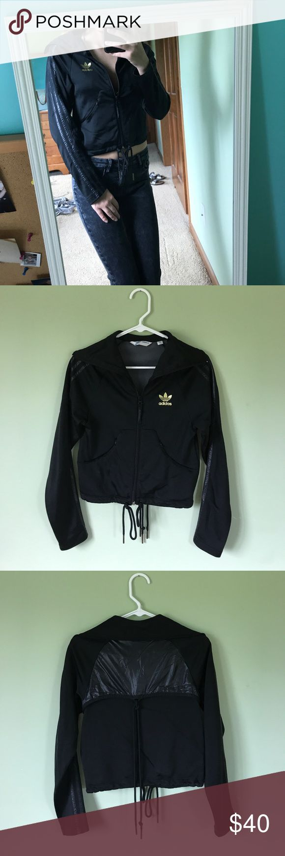 Adidas Zip Up Jacket Slightly cropped adidas zip up jacket. Gold logo, zip pockets, ties for a cinched option around the waist. Like new condition! Make an offer adidas Jackets & Coats