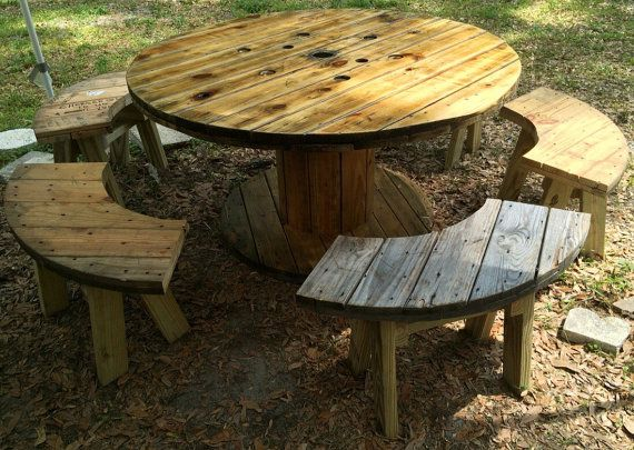Wire Spool Table with Benches  Hand sanded smooth - finished with multiple coats of spar urethane, stained to any color desired. 48 - 72 top diameter 30 - 36 tall 40 - 60 bottom diameter  4, 6 or 8 benches per table. More if requested.  Benches can be customized to any size or shape or height. Different designs available.  They hold over 400 lbs each.  IF YOURE LOOKING FOR A CERTAIN SIZE OR CUSTOM ORDER/LARGE QUANTITIES - just ask me - ill work with any idea.  CUSTOM LOGOS OR STENCILS CAN BE…