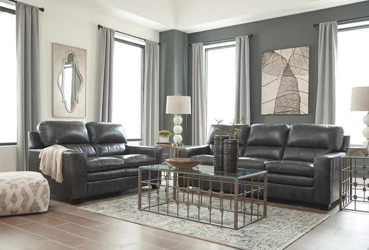 Gleason Contemporary Leather Charcoal Color Sofa And Loveseat. Two-tone charcoal color is accented with contrasting white piping around the arms. Plush divided back and cushiony seats are elevated with designer stitching. #Sofa #Loveseat #Couch #Dark Grey #Gray #Living Room #Modern #Chic #Ashley – Furnituremaxx
