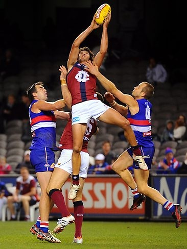 2012 round 13, Rohan Bewick takes a mark (photo by Alex Coppel via Courier Mail) great jersey great mark