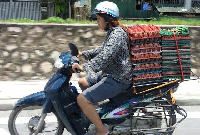 She is transporting eggs!! Hanoi.