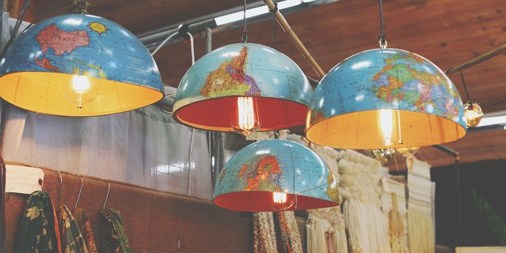 Hanging overhead at Blue Bird Home Decor, we love these repurposed vintage globe lamps.   - CountryLiving.com