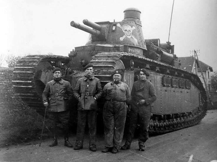 "The crew of a French Char 2C ""Poitou"" super tank pose for the photographer against the backdrop of their behemoth in Briyahe, France, early 1940."