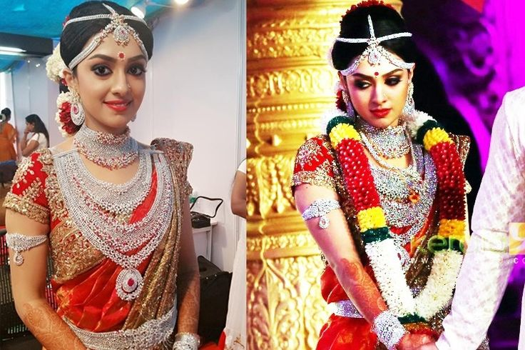 Ravi Pillai's daughter Arathi Pillai Wedding pics. Traditional Southern Indian bride wearing bridal silk saree, jewellery and hairstyle. Diamond jewelry. Silk kanchipuram sari. Braid with fresh flowers. Tamil bride. Hindu bride. Indian Bridal Makeup. Indian Bridal Fashion.