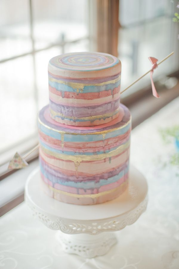 striped wedding cake - photo by Vicki Bartel Photography http://ruffledblog.com/pastel-ontario-wedding-at-sprucewood-shores