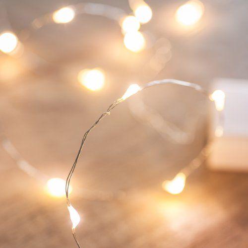 Guirlande Lumineuse à Piles 20 LED Blanches Chaudes Câble Cuivre 1m Pour Noël Mariage Fêtes Lights4fun http://www.amazon.fr/dp/B00EYDMY8K/ref=cm_sw_r_pi_dp_m85hvb051BEPY