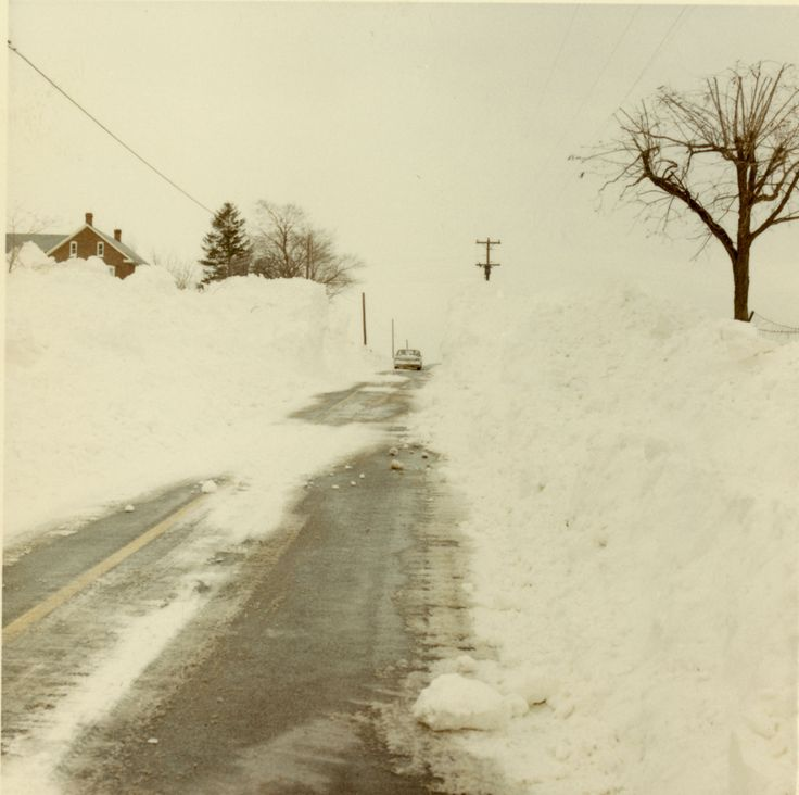 A car makes its way down a cleared road in Franklin County following a snowstorm. This photo, preserved by the Pennsylvania State Archives, is safeguarded in the Records of the Department of Highways (RG-12) collection.  After 1970, the Department of Highways was replaced by the Pennsylvania Department of Transportation (PennDOT) .