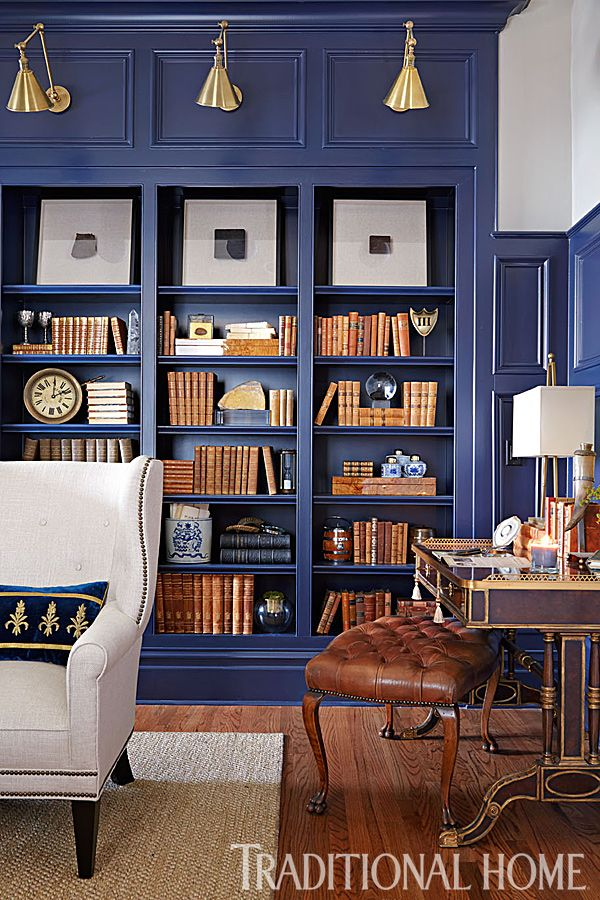 Deep blue paint on the 9-foot-high wall paneling and built-in bookshelves transformed this ho-hum library. - Photo: Werner Straube / Design: Dana Goodman and Crysta A. Parish