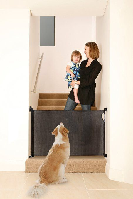 Black Retractable Dog Gate 34 inches tall, expands to 55 inches wide. Comes with two sets of mounting brackets for easy use in more than one place.  No tripping hazard. Retractable design saves you space Dogs simply cannot climb over the gate