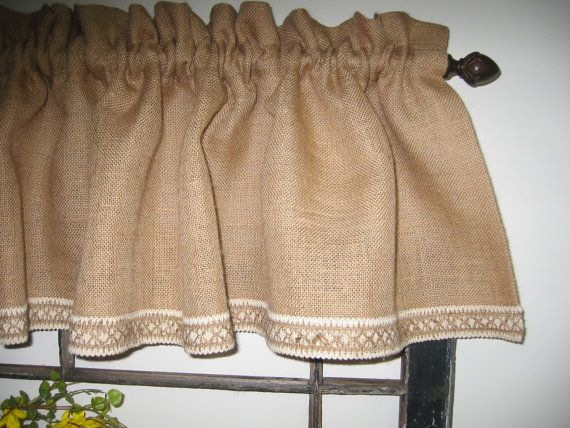 The Burlap Farmhouse Valance is fabricated from a high thread count 100% natural jute burlap. The valance is trimmed at the bottom with a 1 & 1/2 inch wide natural jute and white cotton braid. The valance finishes at 14 inches long. The rod pocket is 1 & 1/2 inches wide. (can be adjusted to a size that will fit your rod leave size in Note to seller area at checkout) This valance is fabricated 2 times the width of the window size for added fullness. Available in Natural color...