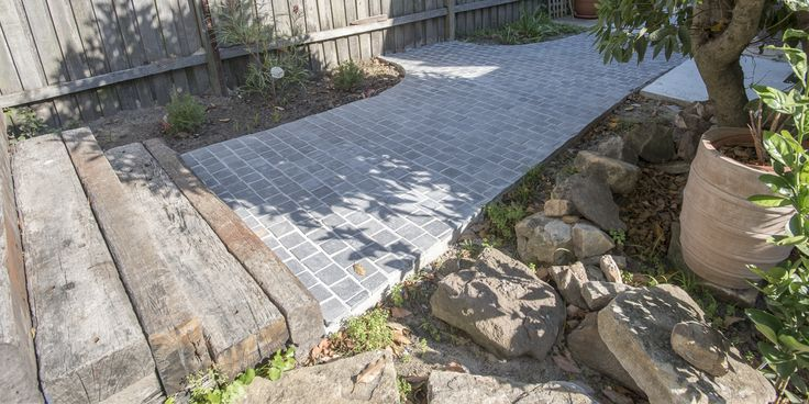 This cobblestone come supplied with a mesh backing, which makes it easy and cost-effective to install. #drivwaystones #cobblestones #cobble #cobbletiles #drivewaypavers #moderndriveway #exteriorpaving #landscapearchitecture