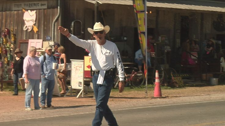 Perry Kram, Deputy Fayette County Sheriff directs the busiest intersection during Antique Week. He is now the Flatonia Chief of Police
