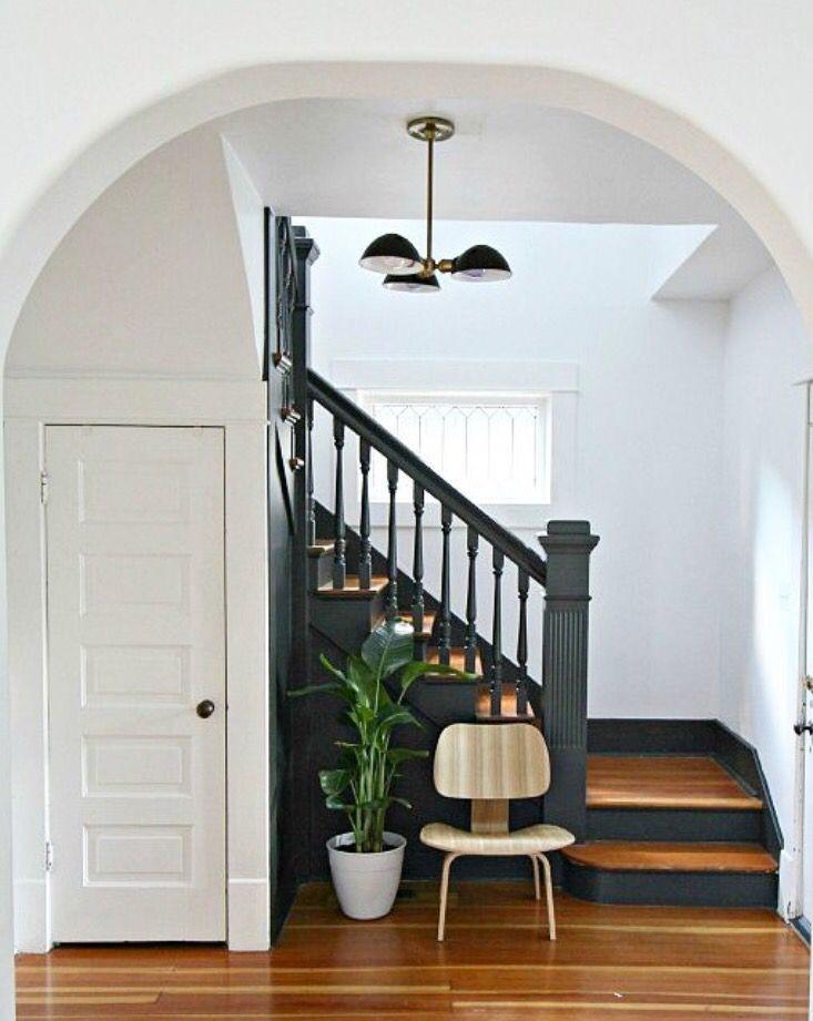 Black stairs:  Benjamin Moore Midnight Oil (1631) in Eggshell. Walls are BM Decorators White (CC-20) in Eggshell.