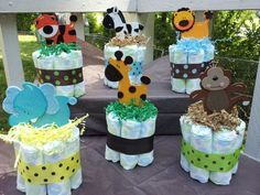 DIY Jungle style Diaper Center Pieces. These are too cute and I believe I could actually make them. I bet you could do Hello Kitty just by changing up the ribbon. and get a cartoon character of kitty herself.