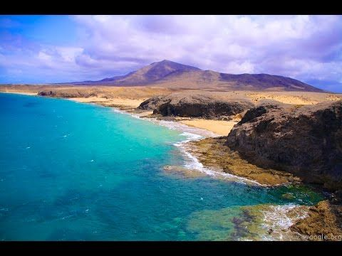 Places to see in ( Lanzarote - Spain )  Lanzarote one of the Canary islands off the coast of West Africa administered by Spain is known for its year-round warm weather beaches and volcanic landscape. Timanfaya National Parks rocky landscape was created by http://www.deepbluediving.org/dive-computer-history/