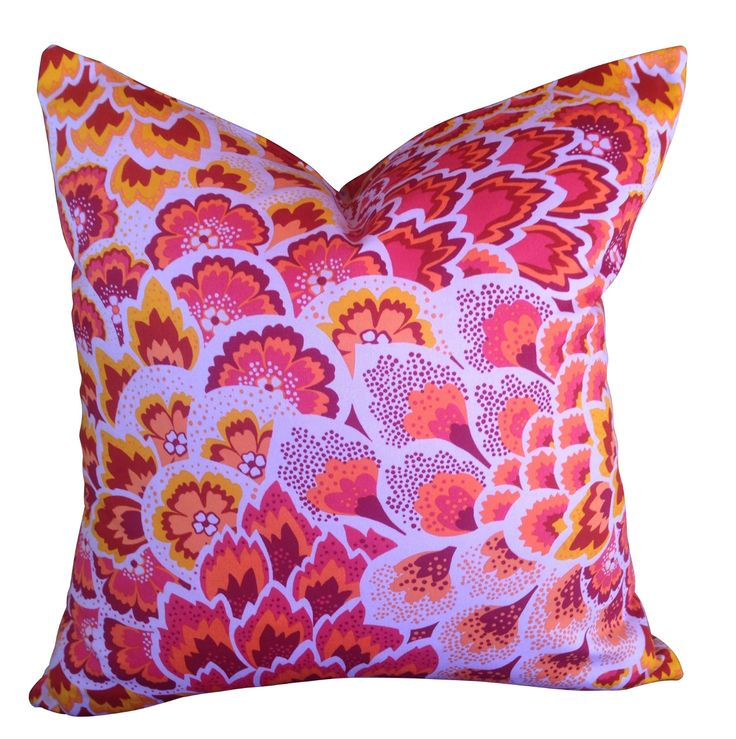 Peacock floral cushion in vibrant pinks with hints of orange