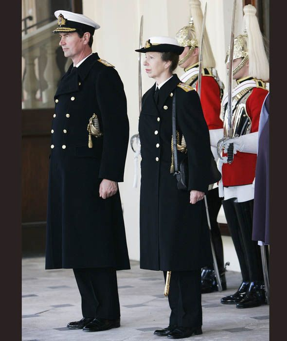 Princess Anne the Princess Royal and her husband Rear Admiral Timothy Laurence in Naval uniform at Buckingham Palace