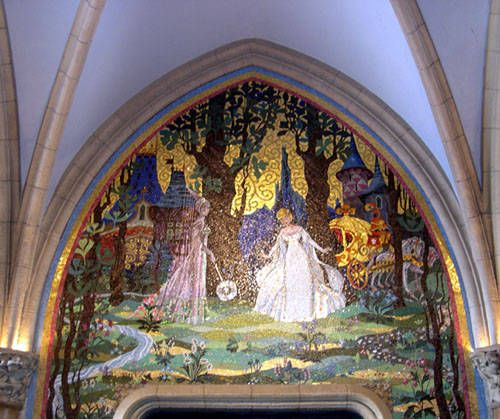 Cinderella's Mural - Outside the Cinderella Suite's main entrance, a mural high on the wall of Cinderella's Castle depicts the future princess and her fairy godmother. You can see this mural yourself when you walk through the castle in the Magic Kingdom.