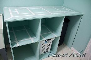 diy folding table and basket storage laundry room, cleaning tips, diy, laundry rooms, painted furniture, storage ideas; love that big trash can can fit under it as well as organize clothes and folding table on top