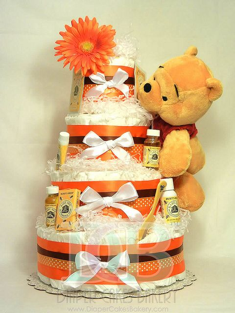 Winnie the Pooh & burts bee's baby shower gift. thinking of doing this diaper cake but with turquoise accents