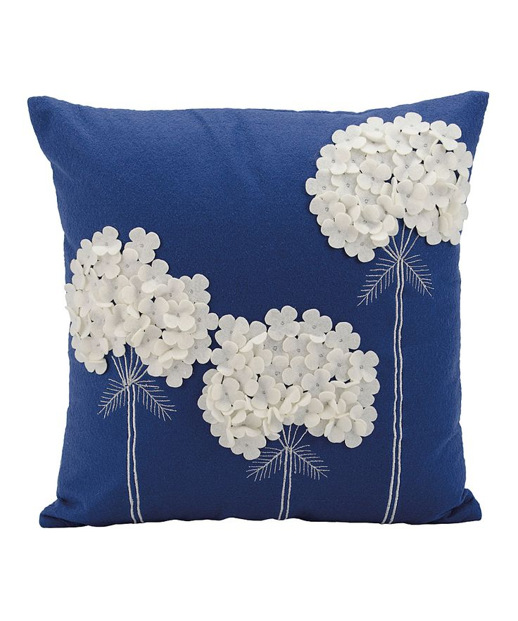 Enliven your home decor with this springy Mina Victory throw pillow by Nourison. Made with hand-cut felt, this joyful throw pillow features a beautiful blue background with a contemporary white floral