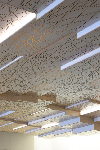 This suspended ceiling is made of a series of boxes made of koto wood. Random perforatio...