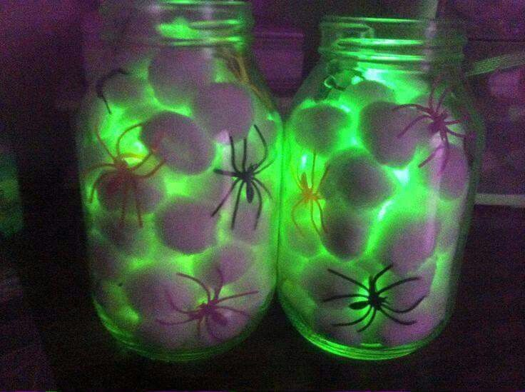 Mason jars, cotton balls, glow sticks, and dollar store spiders