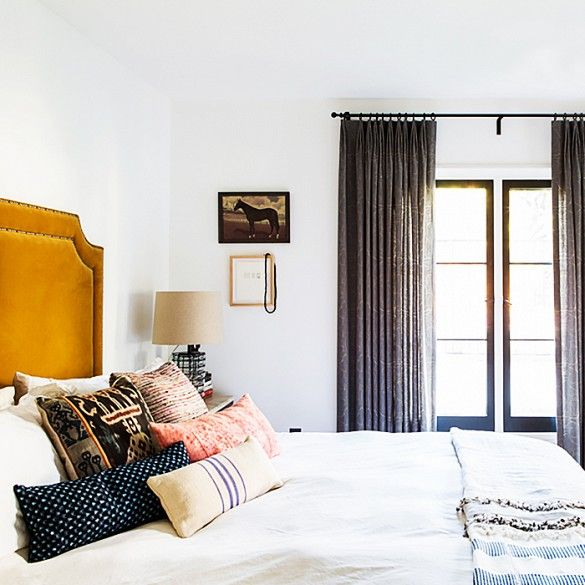 Small Space: 1)Hang your curtains high 2) Stick with White/Light Colors 3) Curtains and furniture in same color as wall OR clear (lucite) will disappear/blend in and not impede the space as much.