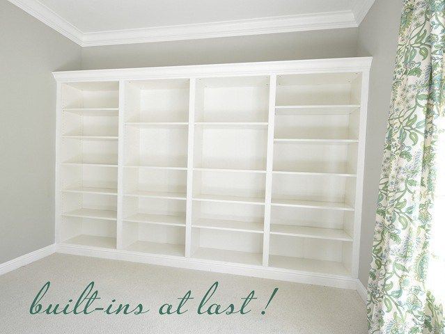 built in billy bookcases using crown molding and ikea bookshelves - this is a must-see