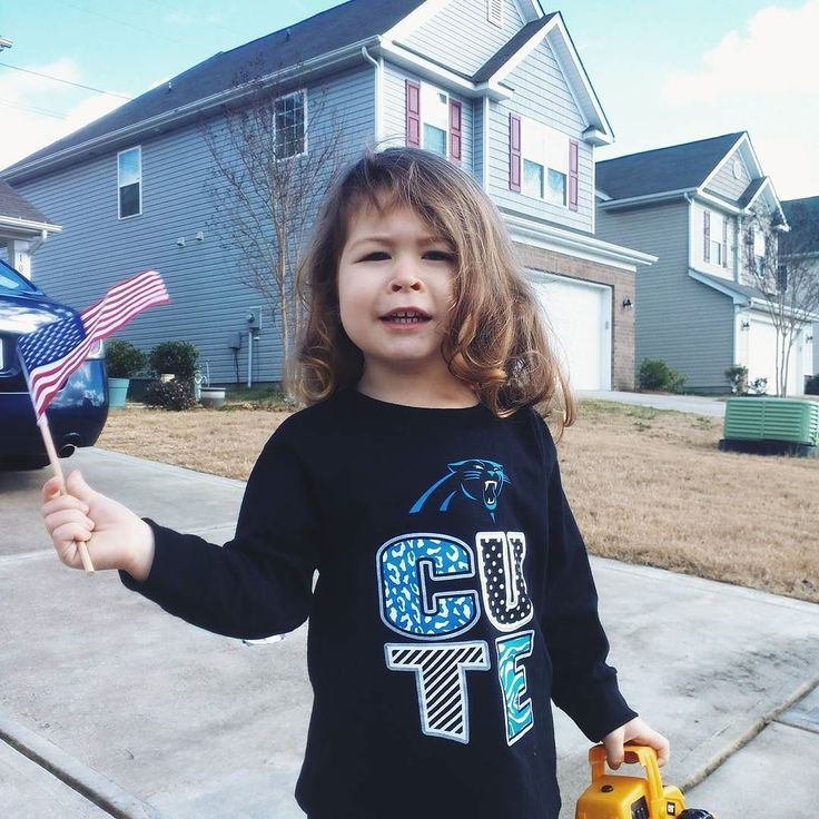 Ariana excited about a #panthers win! #gopanthers #keeppounding #merica #america (Honest caption: she liked the shirt grandpa gave her but was excited about waving the flag.)