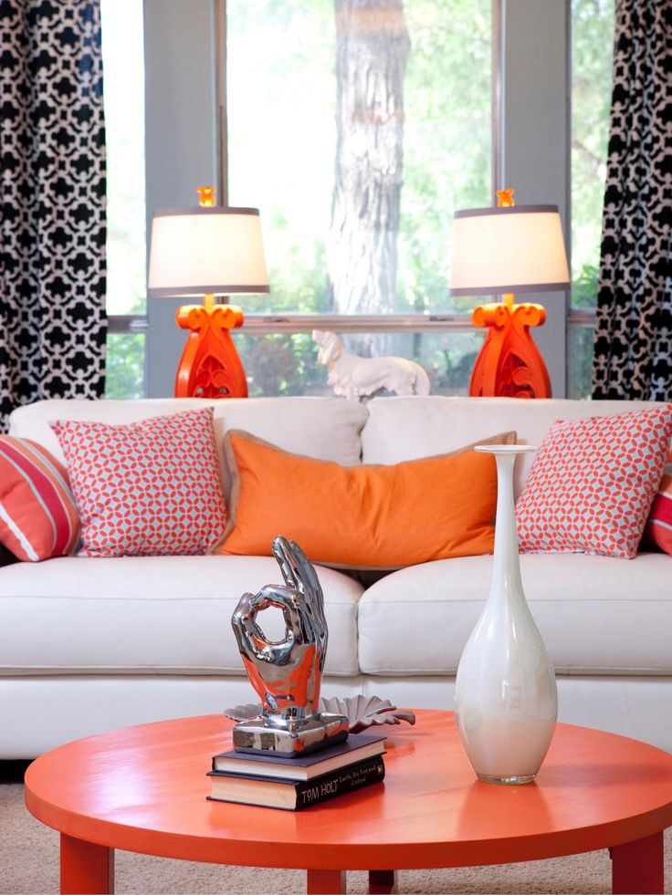 A pedestal table with four orange chairs provides extra space for laptops  or meetings with clients in this masculine office  Bold patterned wall  paper is  Best 25  Orange lamps ideas only on Pinterest   Orange  Orange  . Orange Living Room Furniture. Home Design Ideas