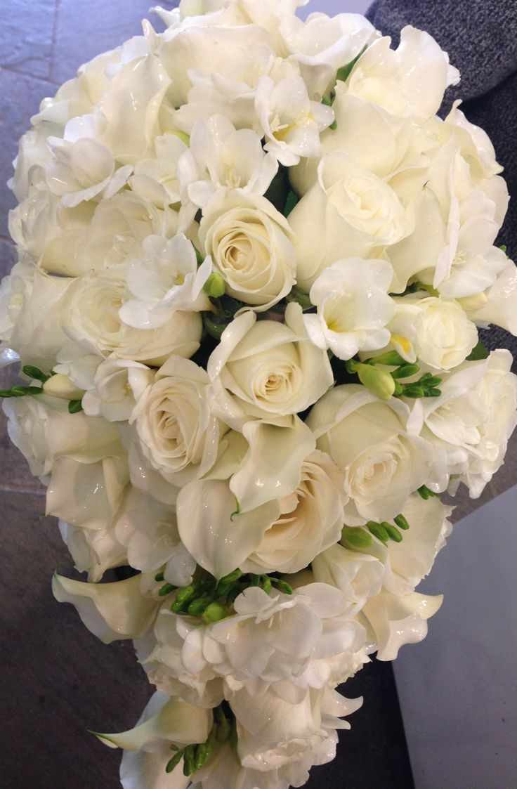 195 best trailing bouquets images on pinterest cascade bouquet a classic teardrop bridal bouquet of roses and white freesia dhlflorist Choice Image