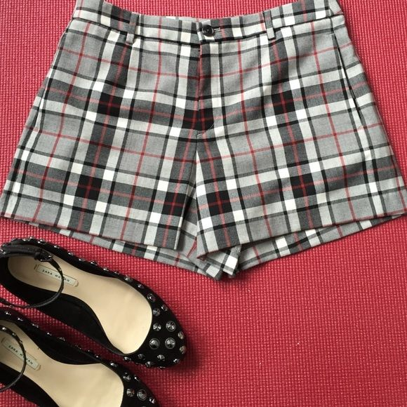 Like new cool & funky Uniqlo shorts Worn once! These are cool/punk/classic/whatever you want plaid shorts from Uniqlo. The plaid is red, black, and gray tones. Like new condition, no signs of wear. Belt loops, covered zip front, side-seam pockets. The shoes shown in the item photo (same ones as in my pic) are available in my closet! UNIQLO Shorts