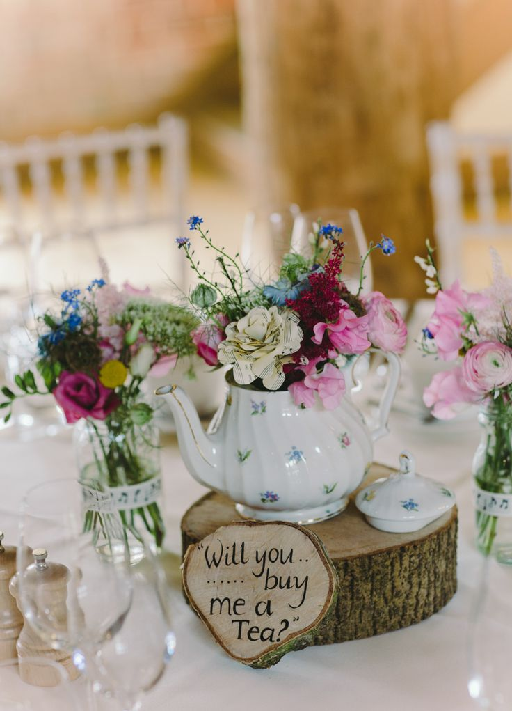 Teapot floral centrepiece - Image by Charli Photography - Lusan Mandongus Lace Dress for a rustic wedding in barn with musical theme and pastel colour scheme.